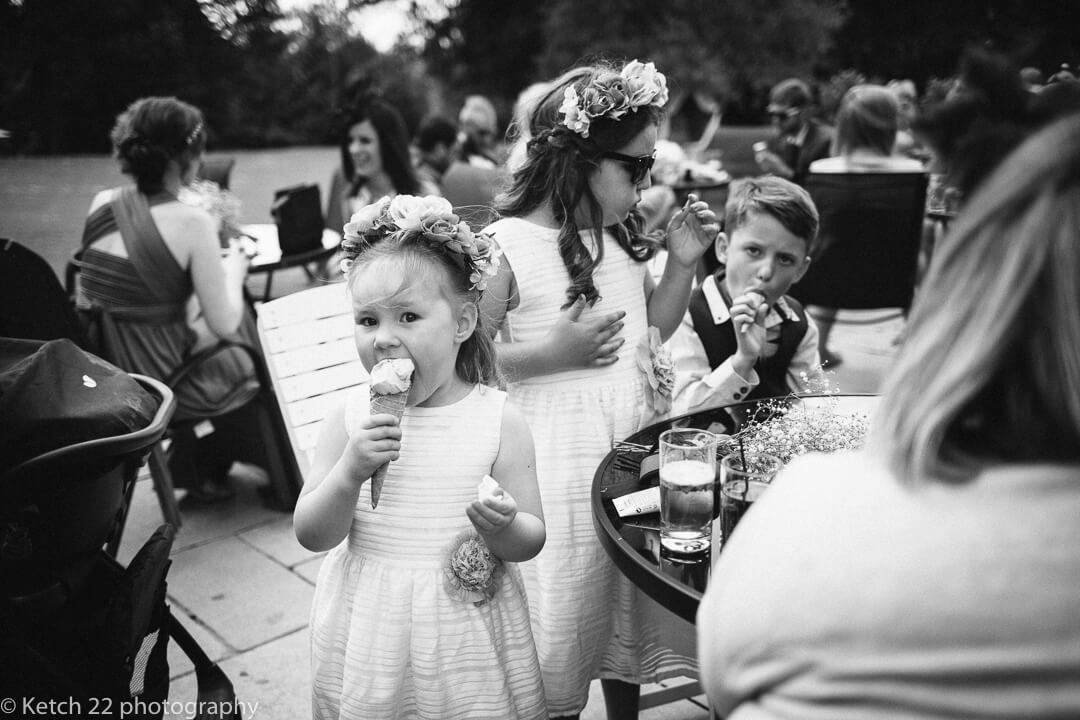 Kids eating ice cream at eastington Park wedding in Gloucestershire