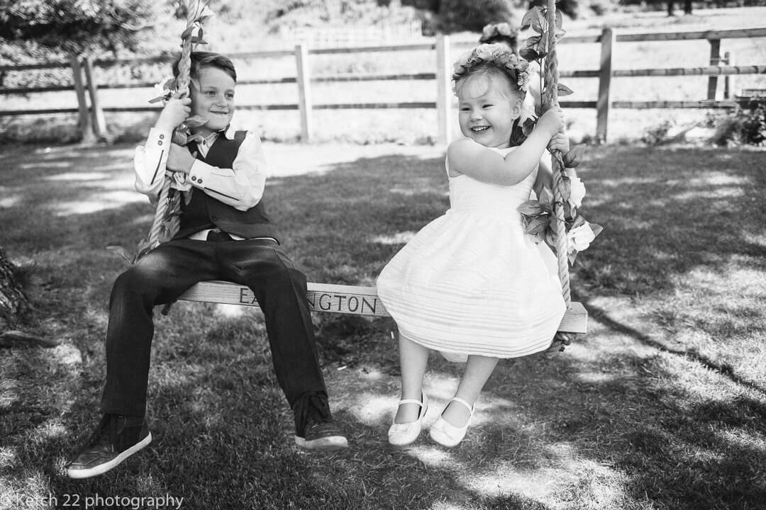 Kids playing on swing at Country house wedding