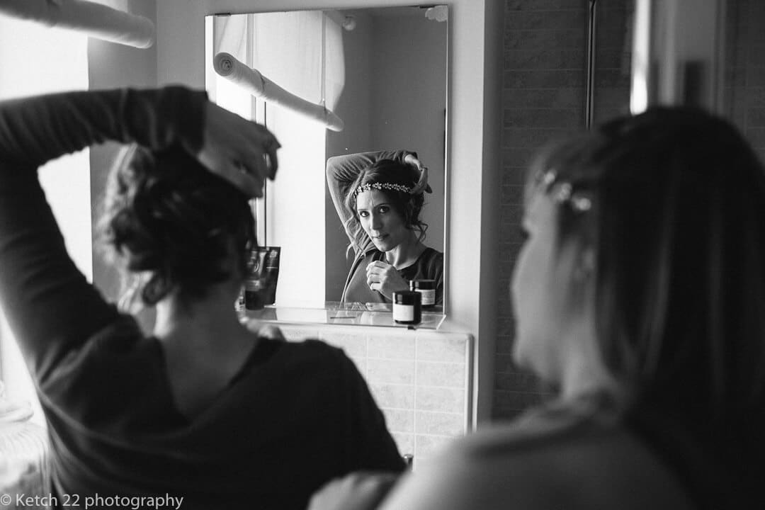 Bridesmaid getting ready at wedding preparations