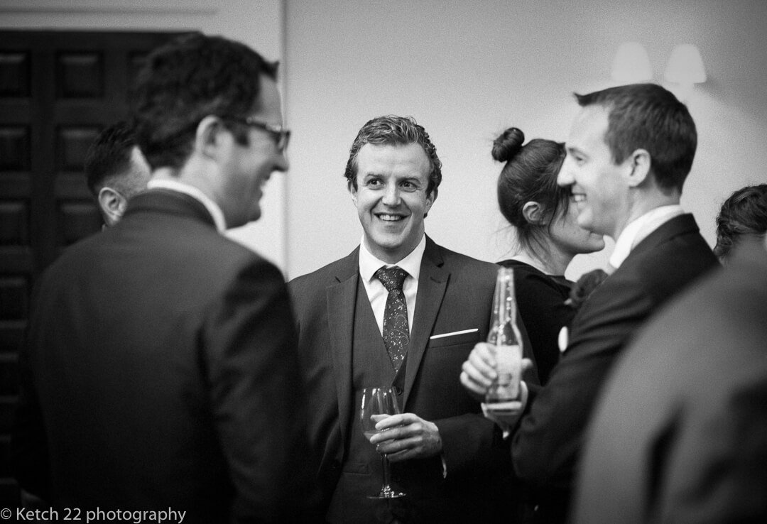 Wedding guests chatting and laughing at Country House wedding