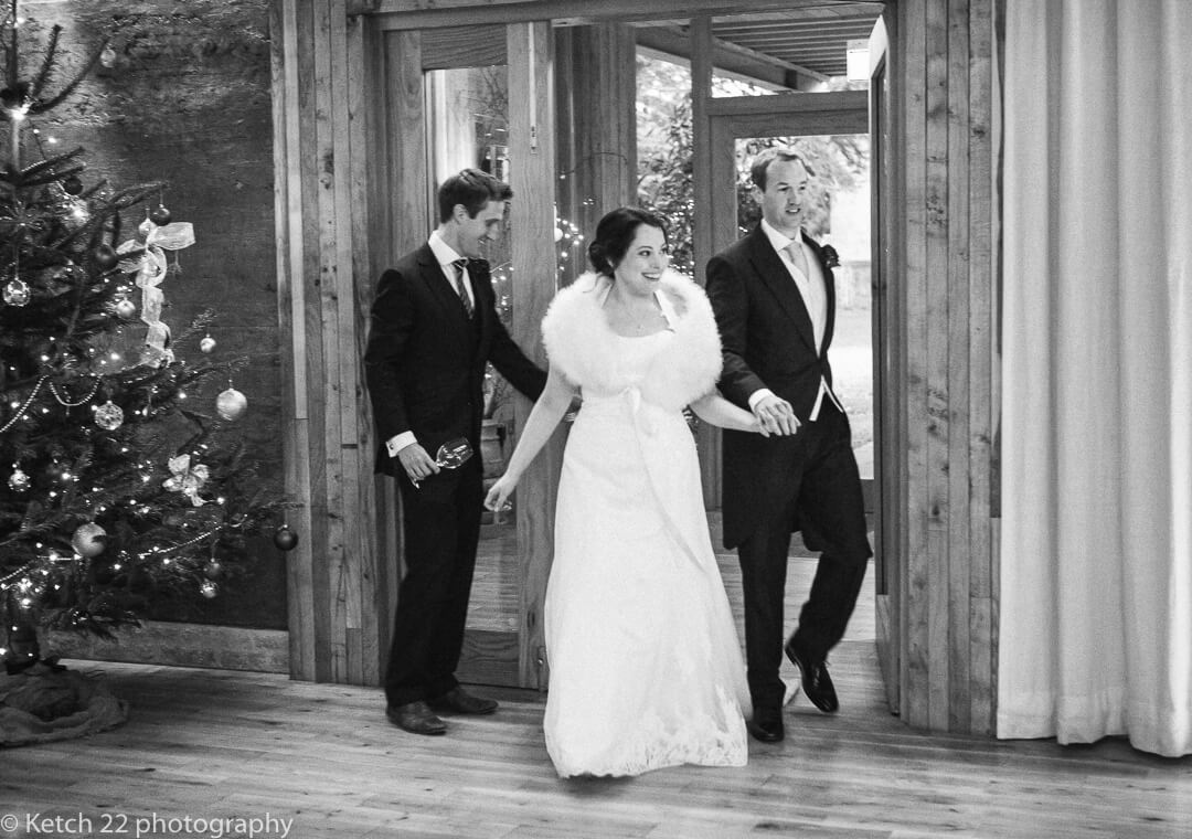 Bride and groom enter dinning room at wedding reception