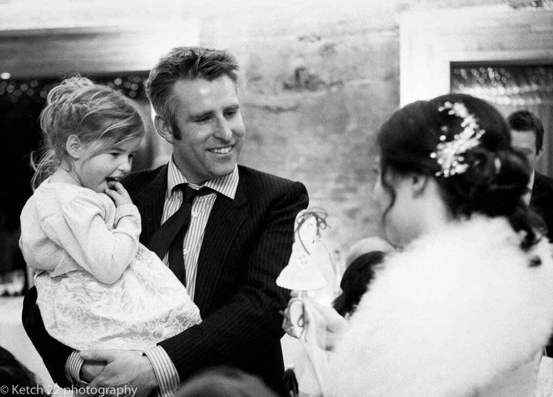 Father and daughter talking to bride at wedding reception