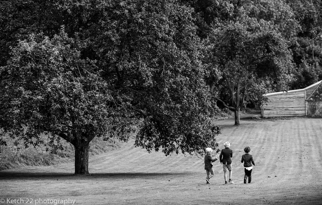 Kids walking in the Hilles House gardens at wedding