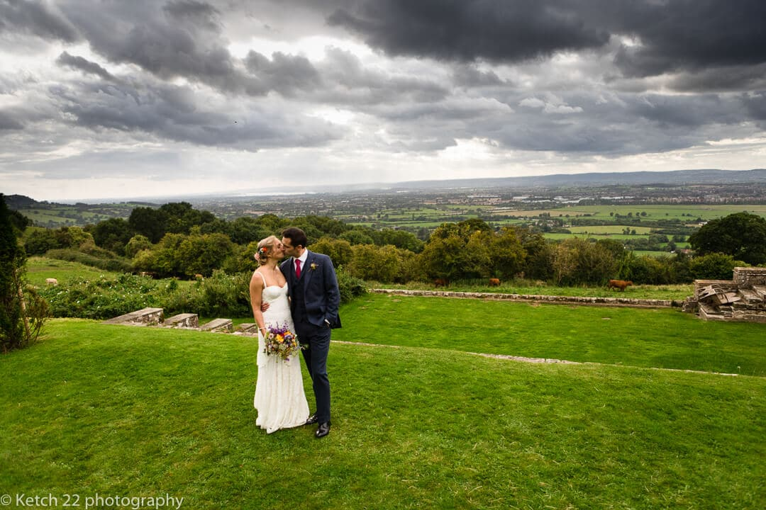 Romantic portrait of bride and groom in Gloucestershire rural landscape