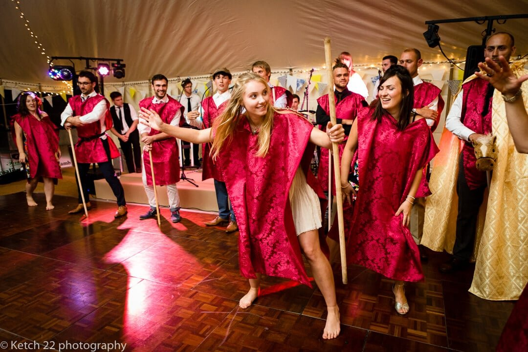 Entertainers in red at marquee summer wedding