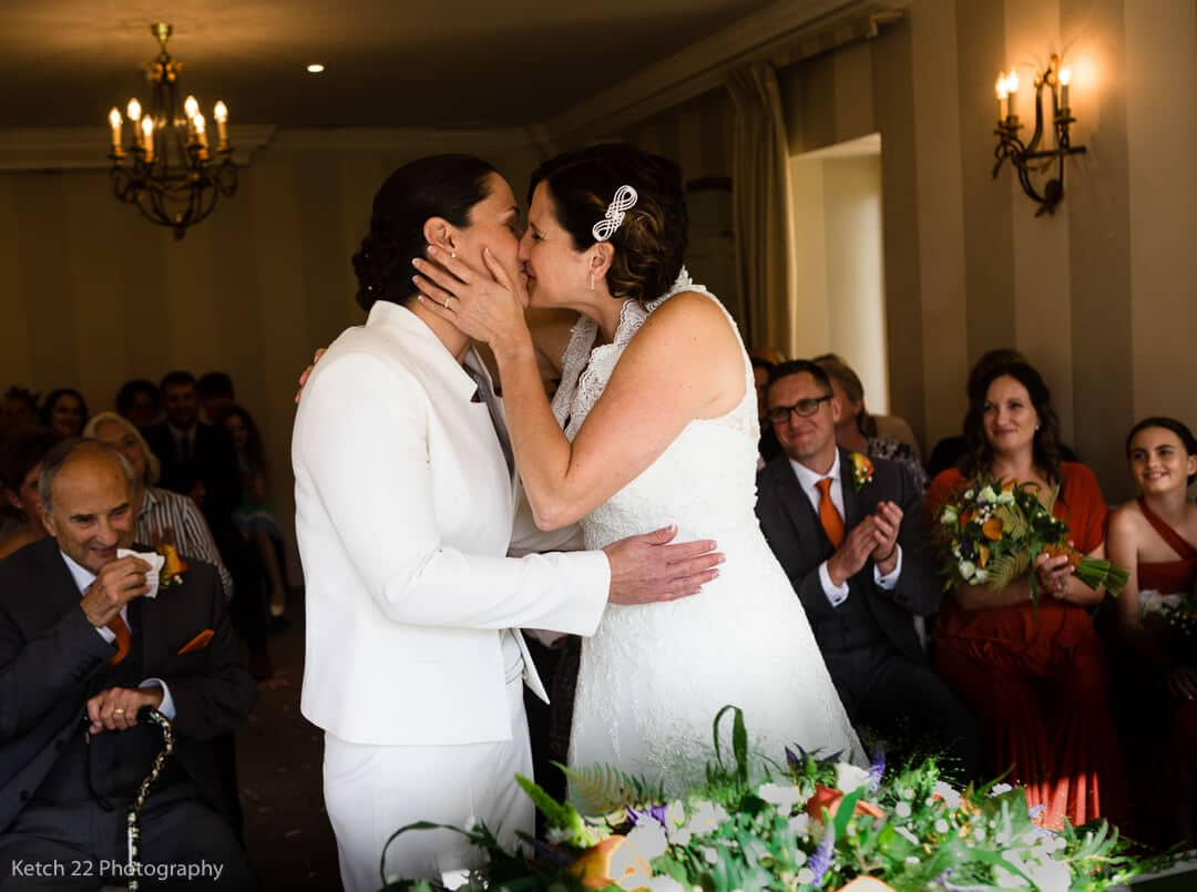 Newly weds kissing just after wedding ceremony