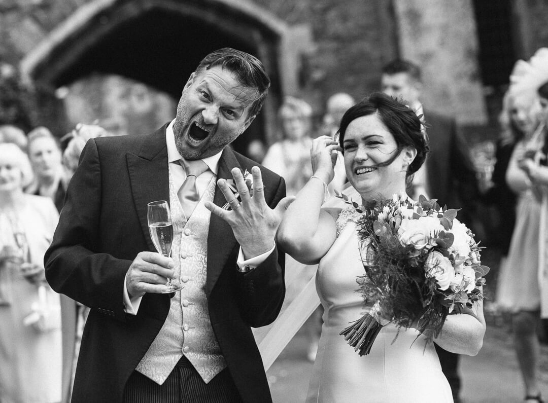 Funny and quirky photo of groom showing off his wedding ring