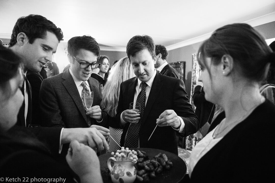 Wedding guests enjoying canapes at wedding in Oxfordshire