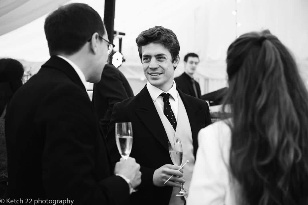 Wedding guests chatting at reception in Oxfordshire