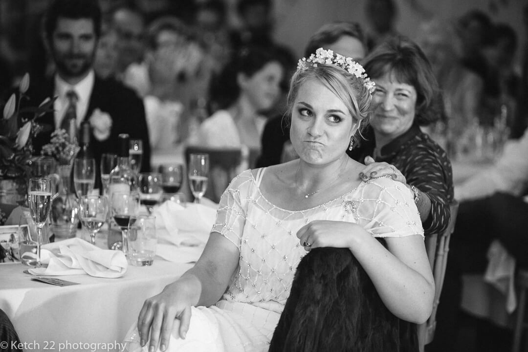 Bride making silly face at documentary wedding photography Oxfordshire