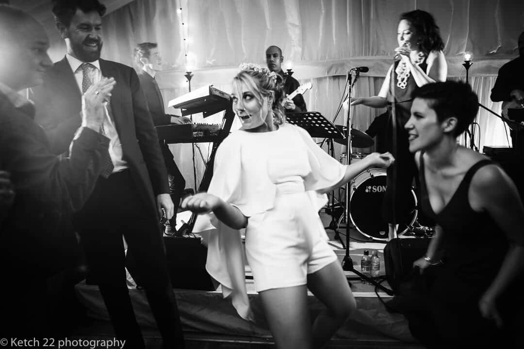 Bride dancing at Oxfordshire wedding