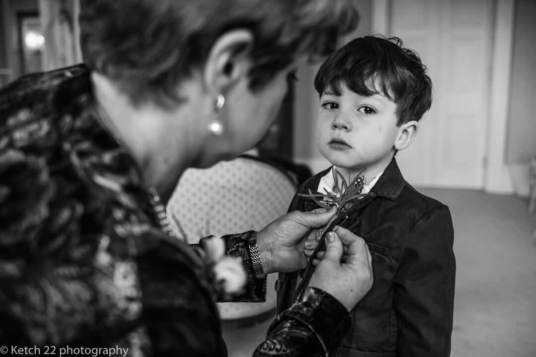 Page boy getting ready at documentary wedding