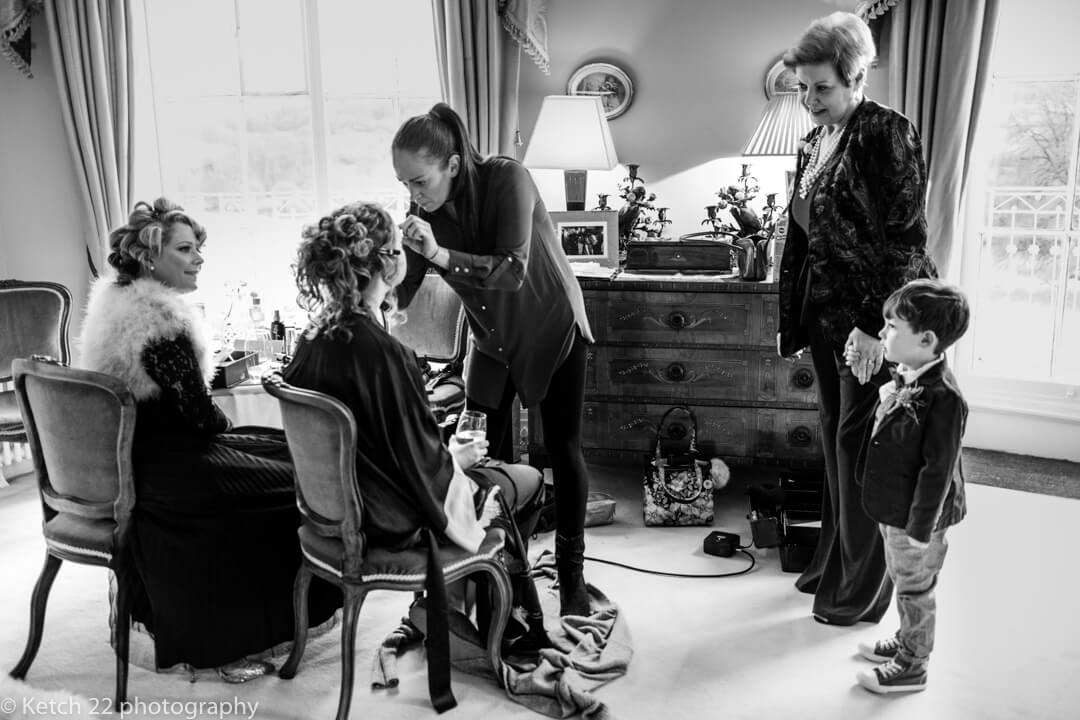 Candid wedding photo of bride getting ready at Somerset wedding