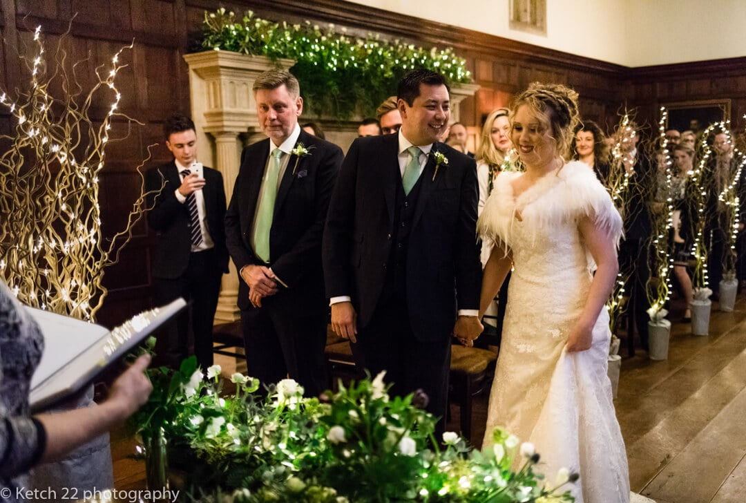 Groom looks at bride for the first time just before wedding ceremony