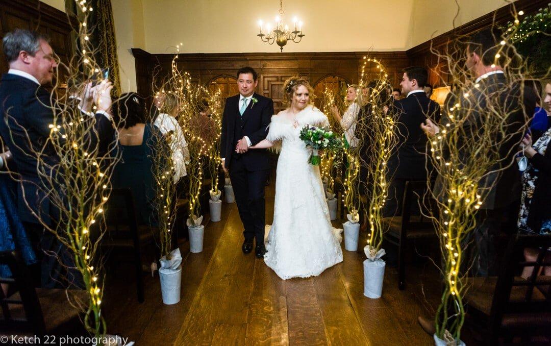 Bride and groom walking down aisle at North cadbury Court wedding
