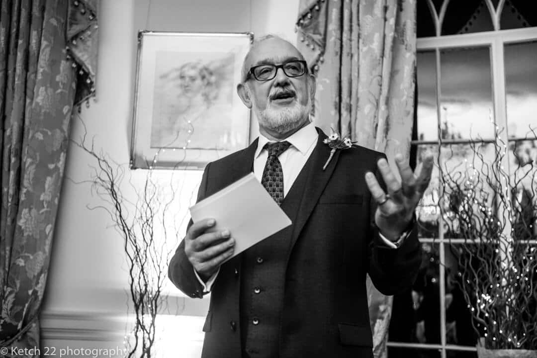 Reportage wedding photo of Father of bride making speech