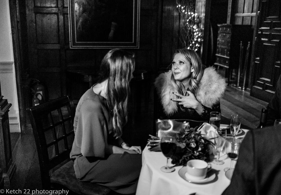 Bridesmaid making conversation at Somerset wedding