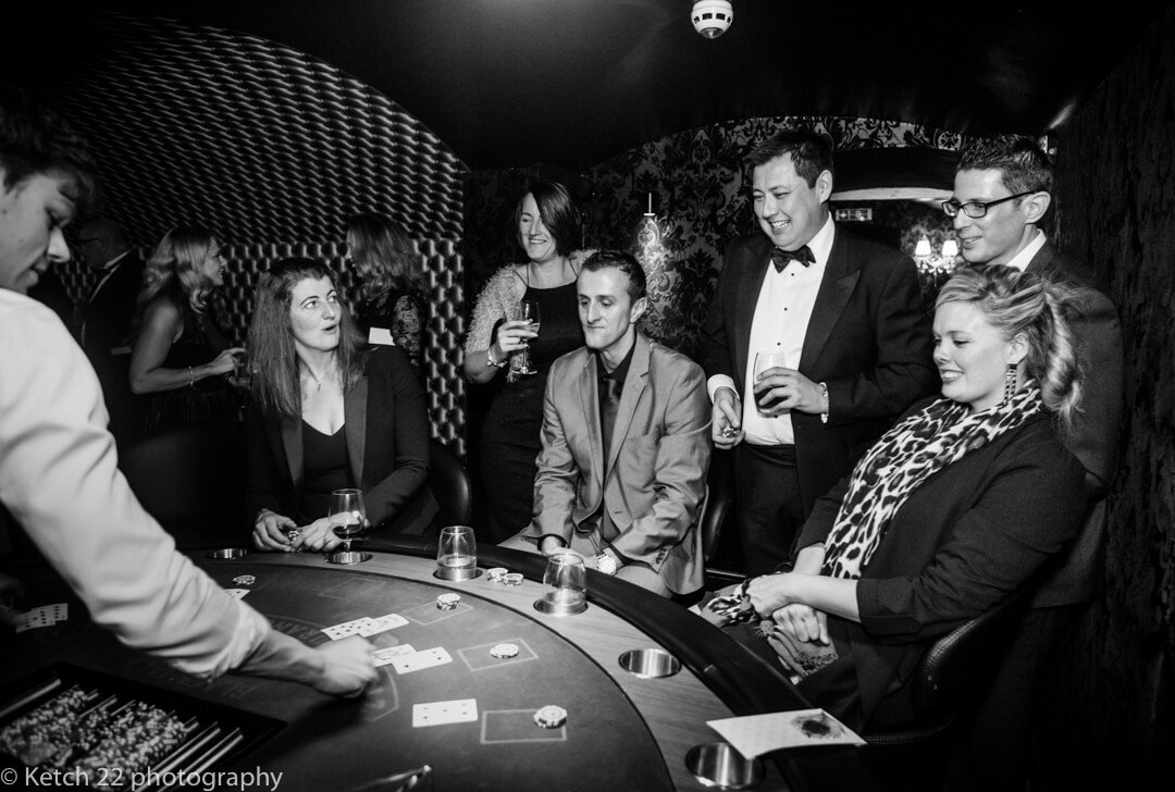 Wedding guests playing cards at North Cadbury Court casino