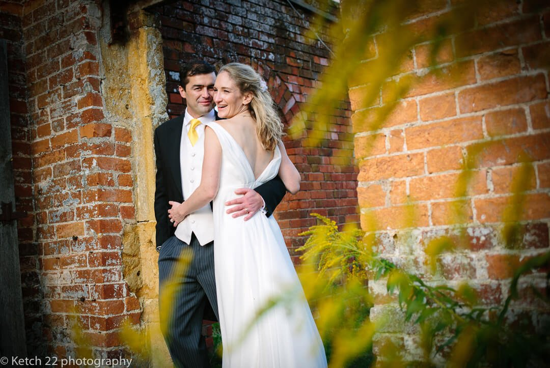 Portrait of bride and groom in garden at summer wedding