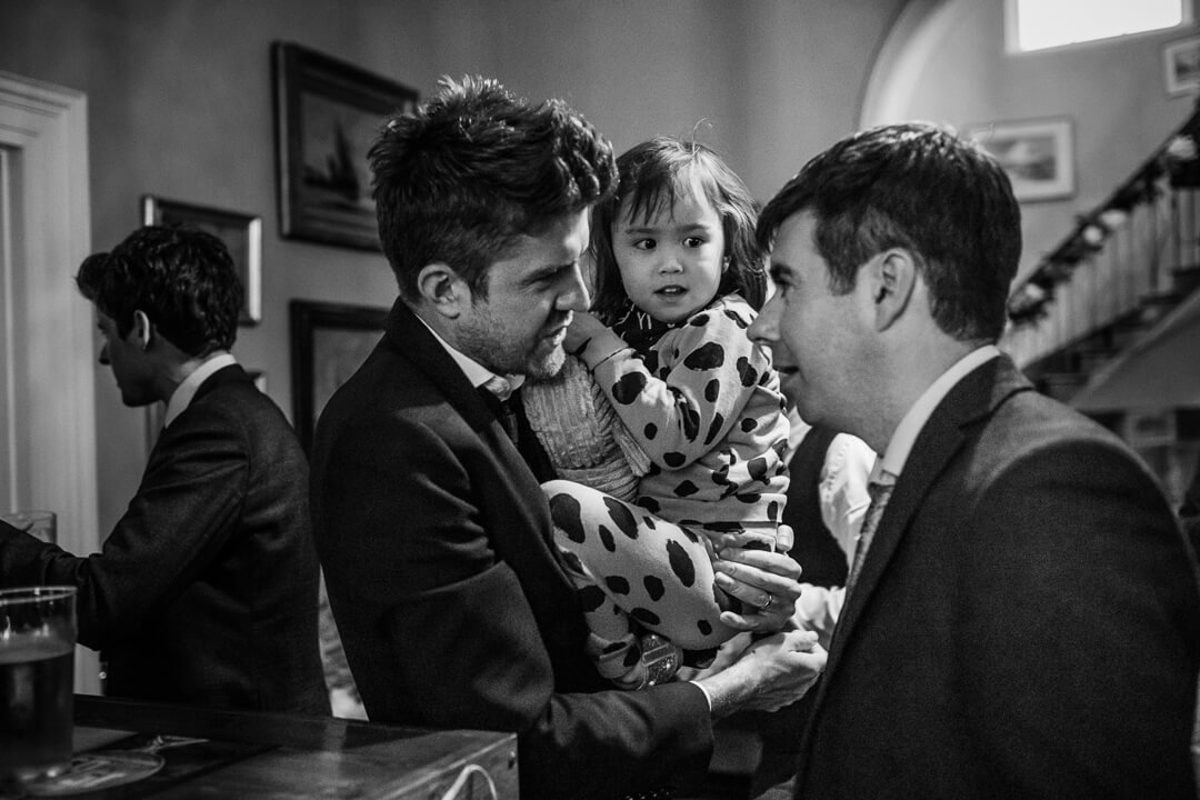 Little girl stays close to her Dad at Homme House wedding