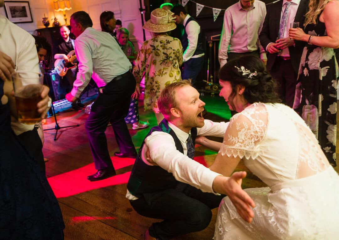 Bride and groom dancing at Homme House wedding reception