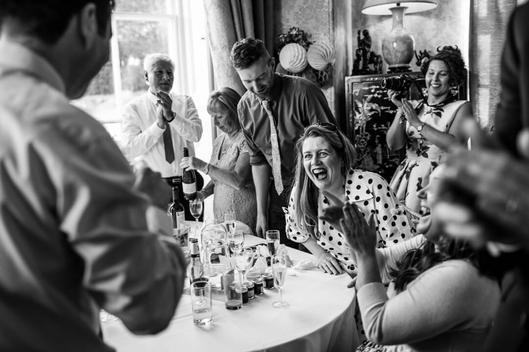 Guests reacting to speeches at Homme House wedding