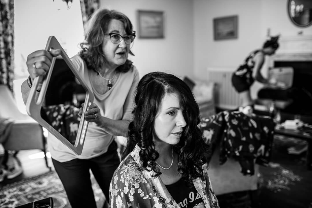 Story telling photo of bride getting ready at wedding