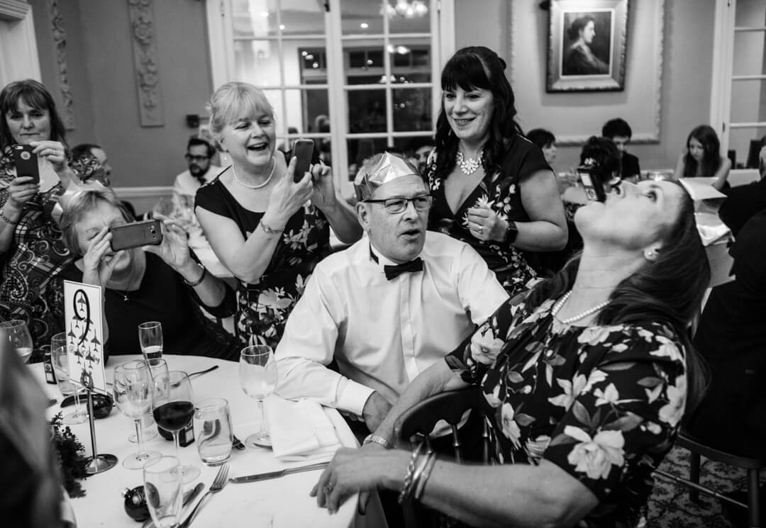 Guests knocking shots back at a Winter Welsh Wedding