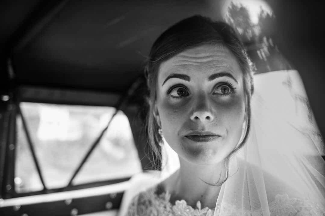 Bride looking out of wedding car window