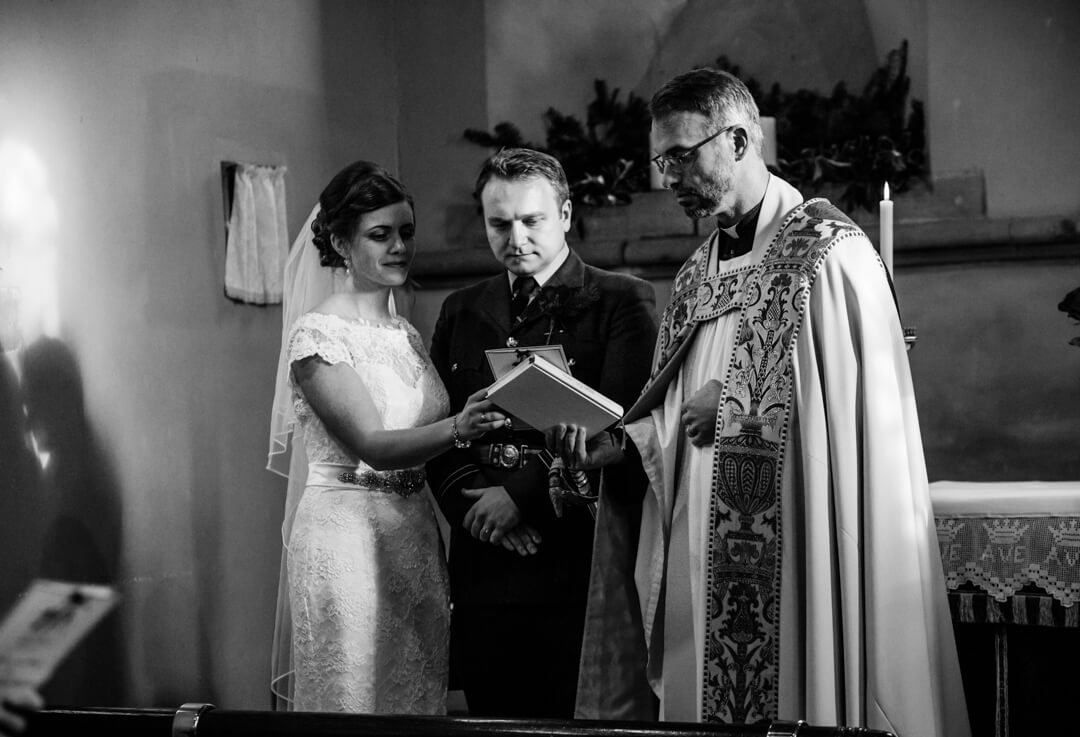 Documentary wedding photo of bride and groom in church