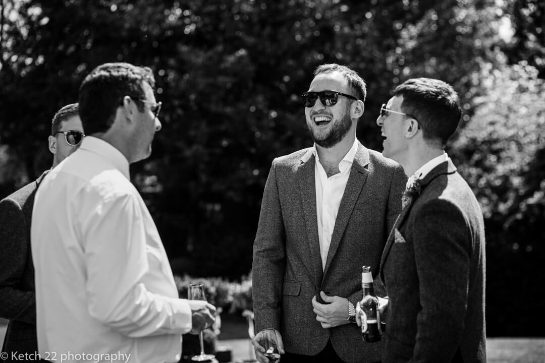 Wedding guests laughing in garden