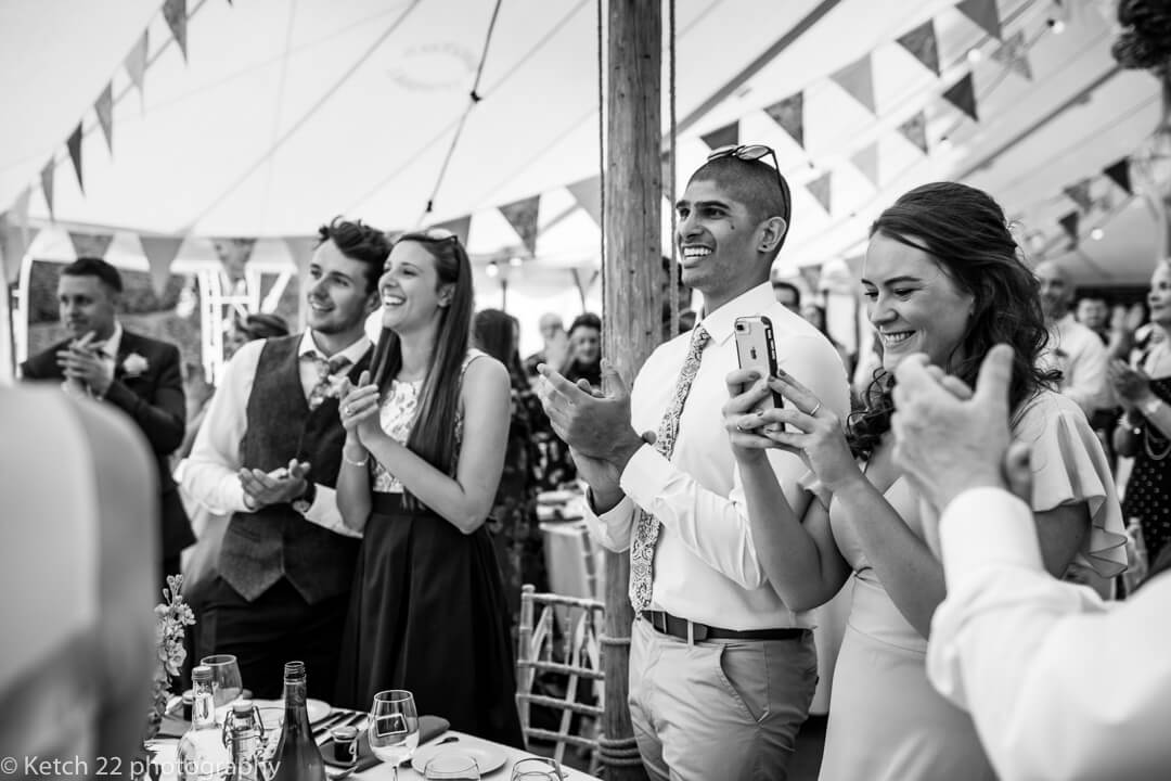 Wedding guests clapping at Marquee wedding