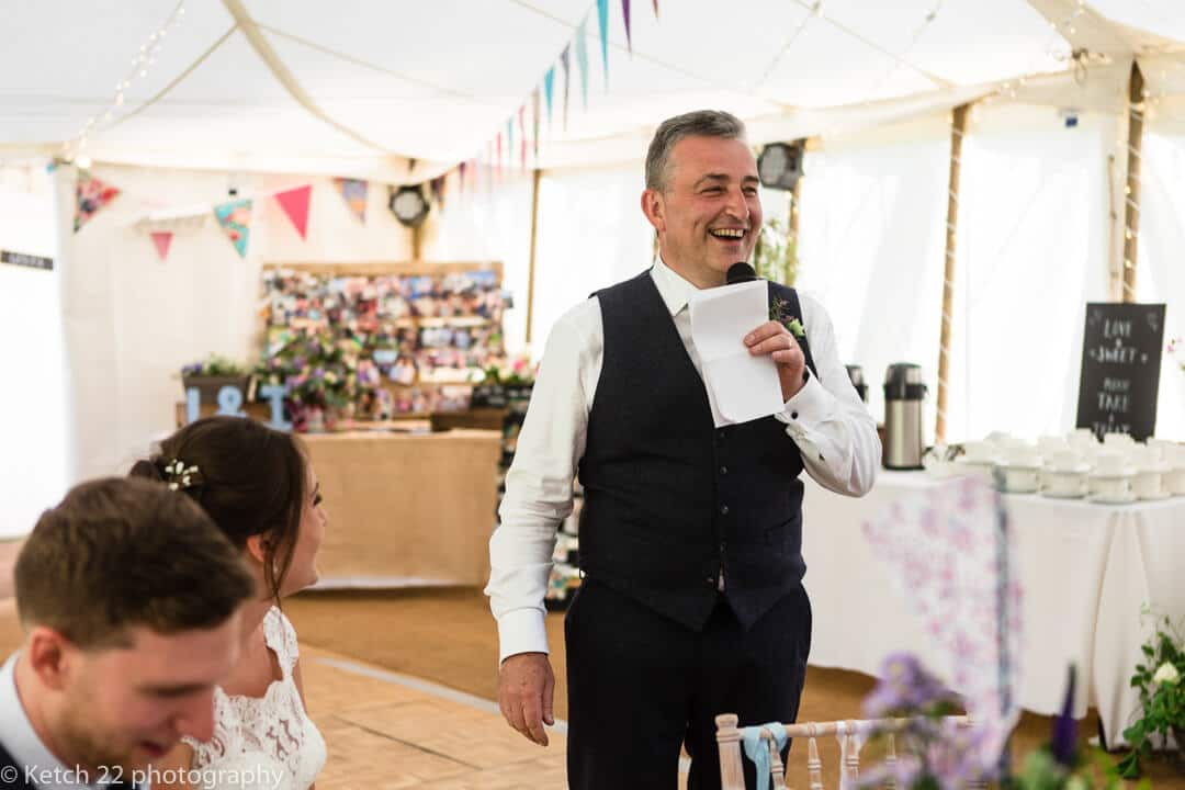 Father of bride speaking at wedding