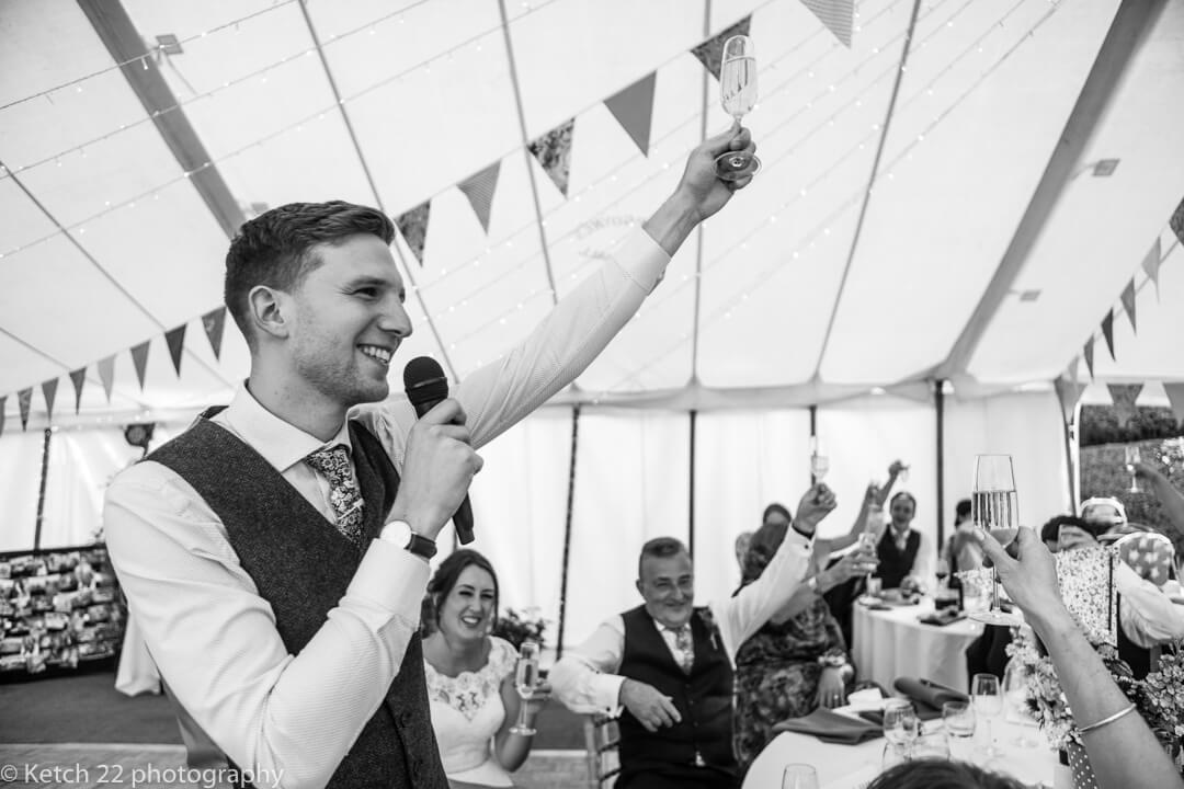 Groom toasting the bride at wedding speech