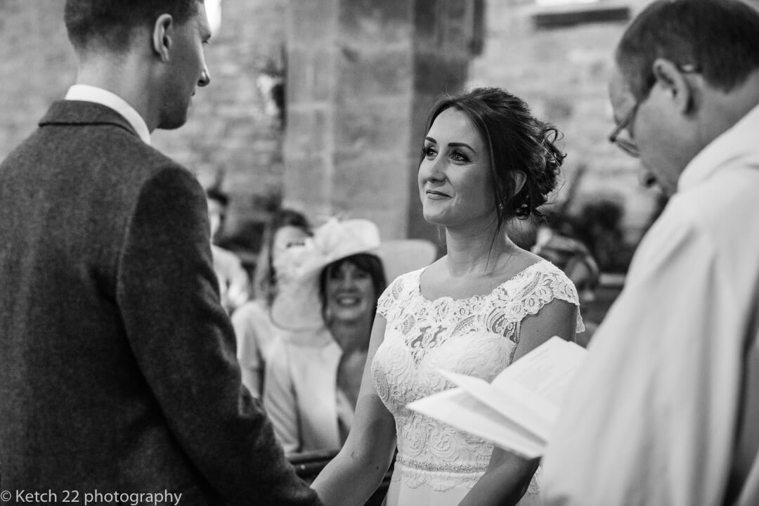 Bride looking into grooms eyes at church wedding ceremony