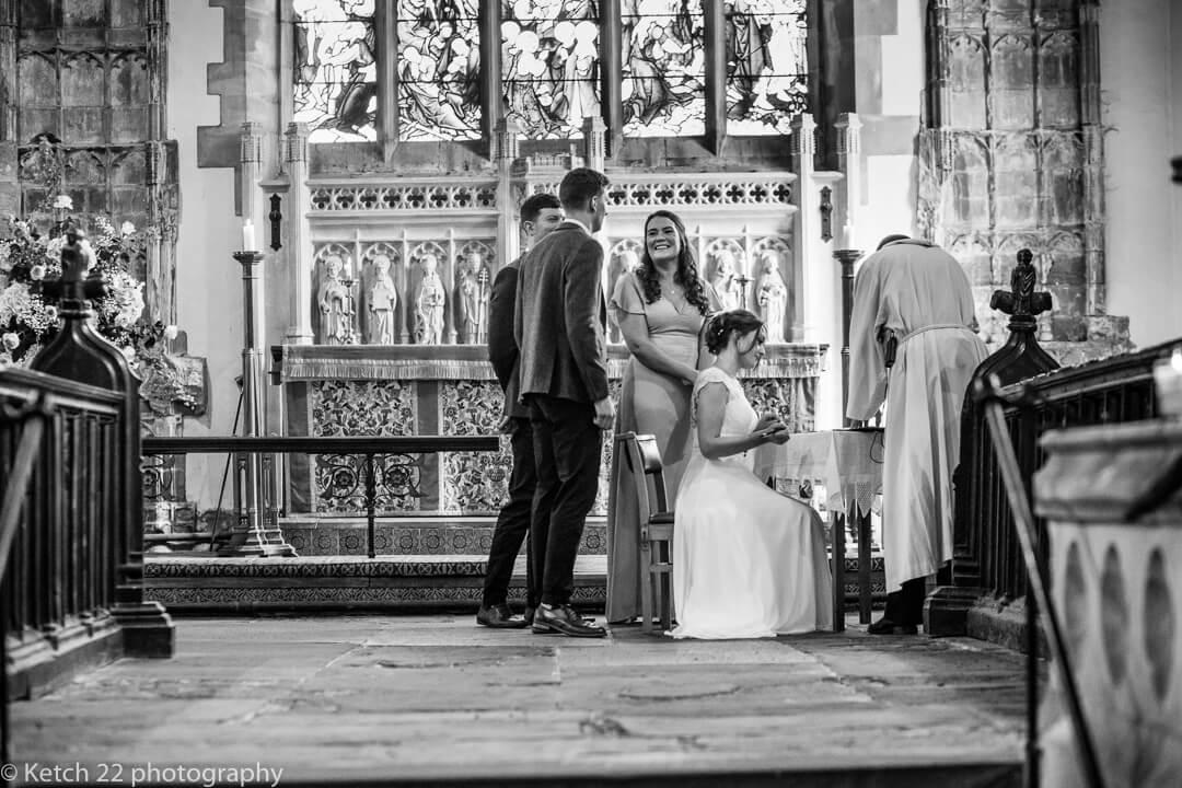 Bride signing the registrar at country church wedding