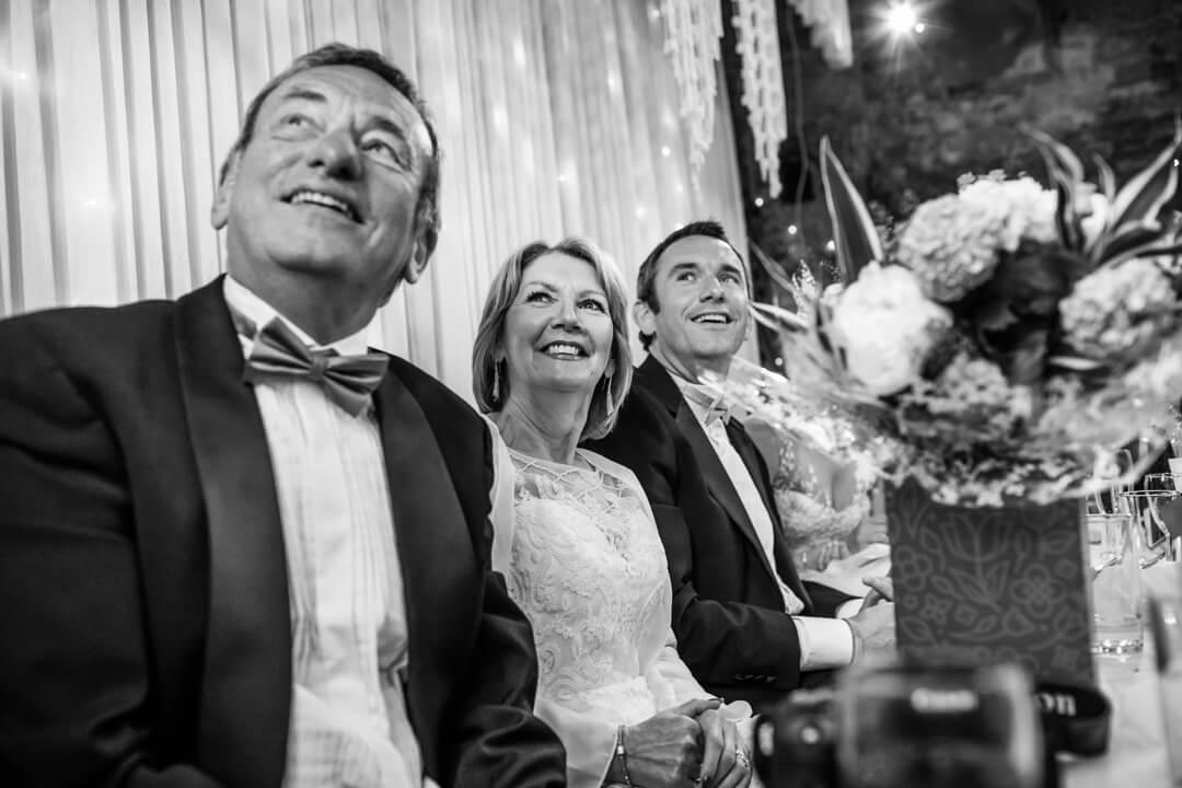 Wedding guests looking at slideshow
