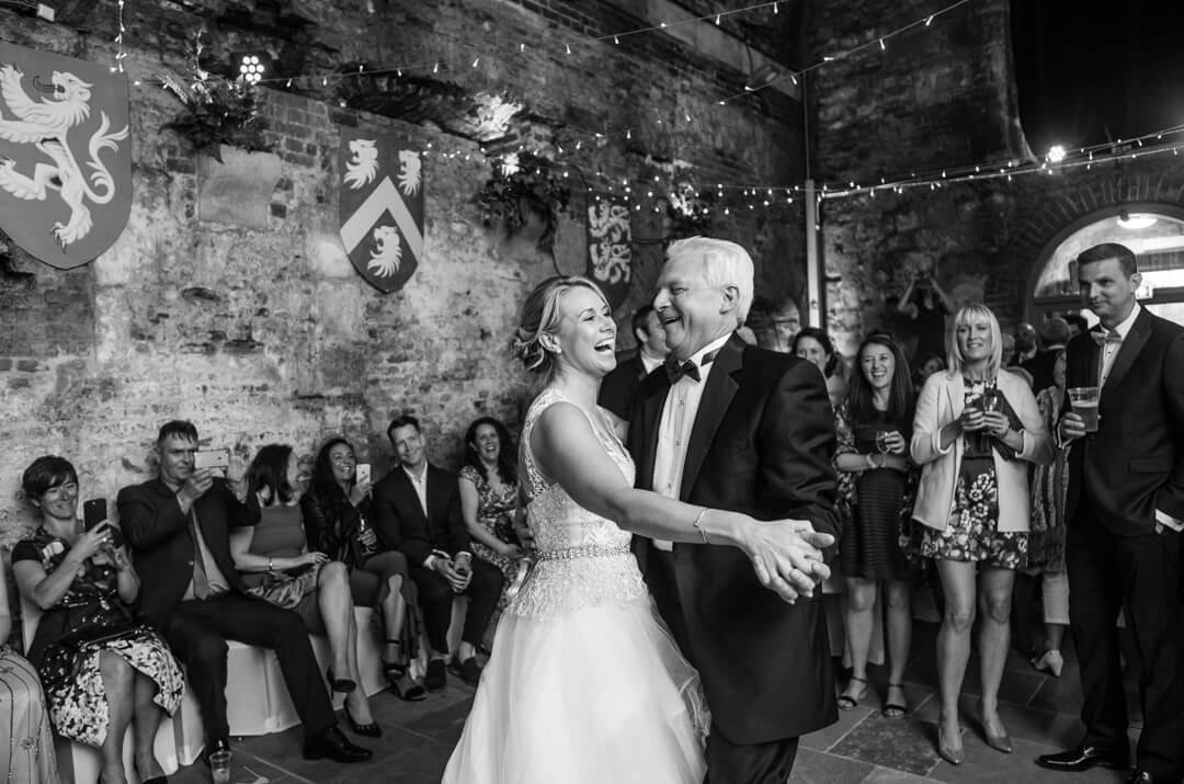 candid wedding photo of bride dancing with her father at The Square Tower Wedding Portsmouth