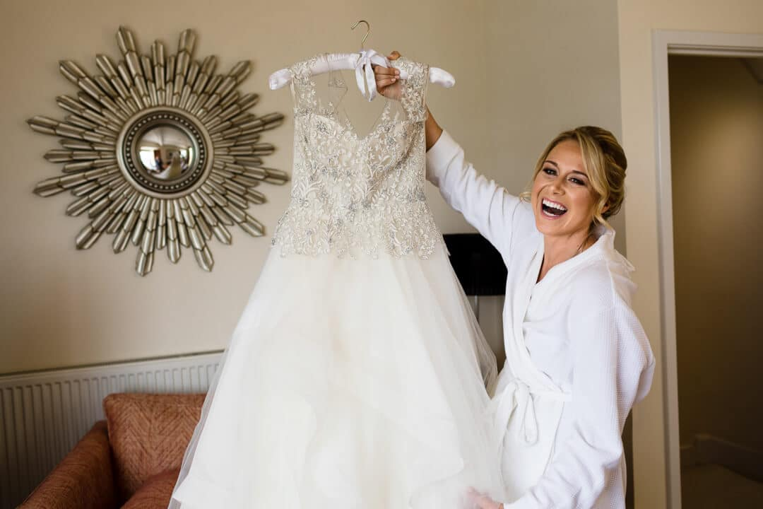 Bride shows off her dress at wedding preparations