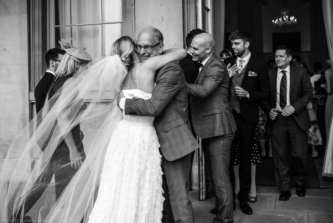 Dad hugging bride at Cheltenham wedding ceremony Gloucestershire