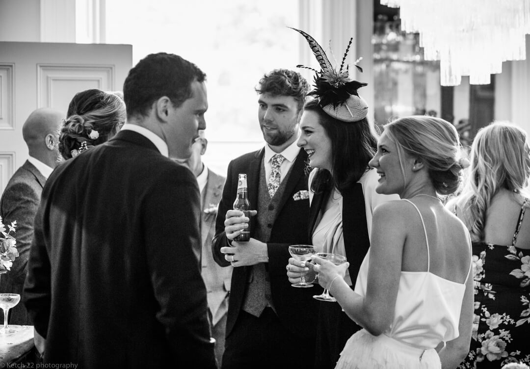 Wedding guests chatting at No 38
