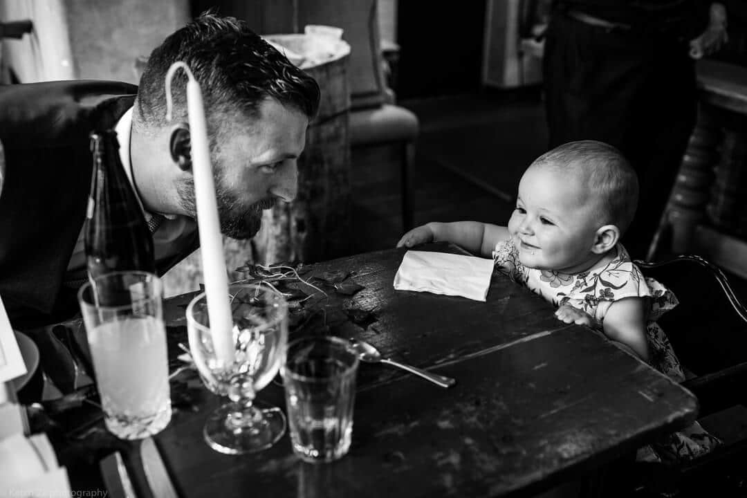 Dad and baby at wedding