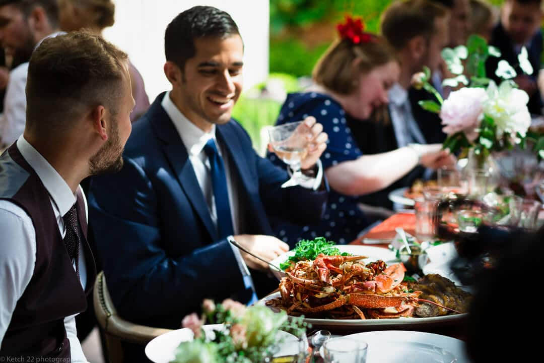 Wedding guests enjoy lobster meal