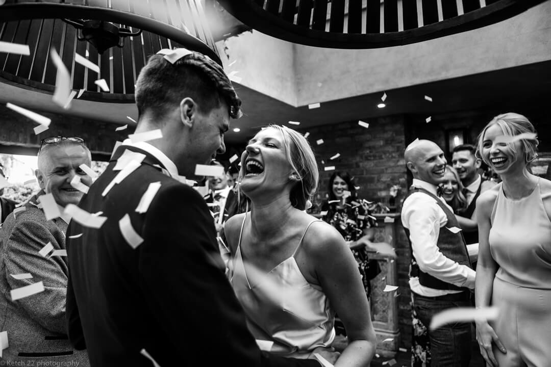 Bride and groom get showered with confetti during fast dance at No 38 wedding Cheltenham
