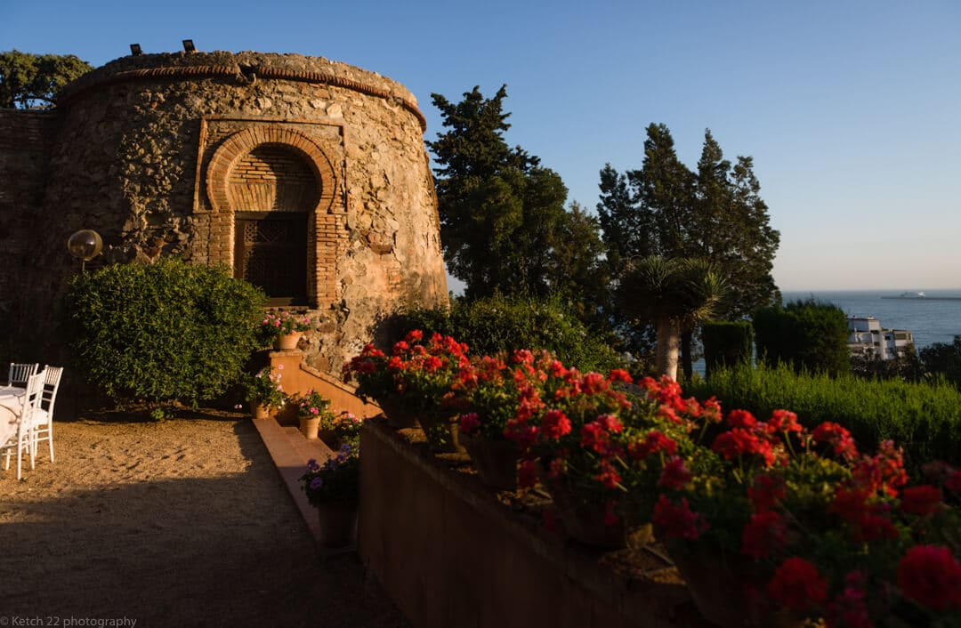 Moorish castle tower and red flowers at Malaga wedding venue