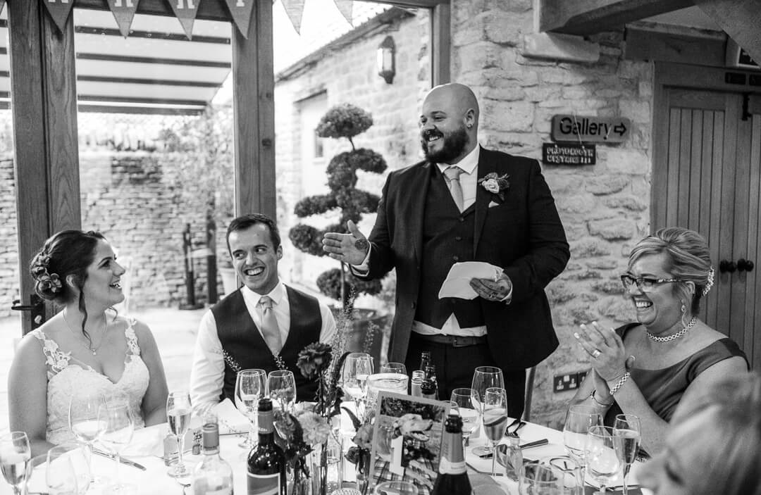 Best man making speech at Kingscote Barn Wedding