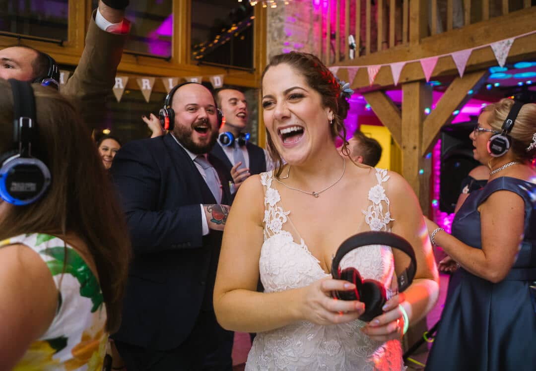 Bride laughing at evening wedding party