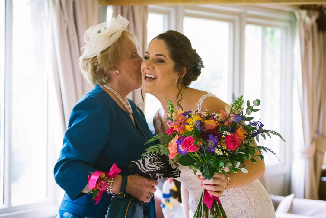 grandma kisses bride at preparations