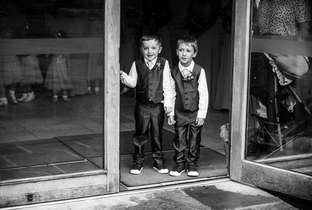 Page boys onlooker at bride arrives at Kingscote Barn Wedding