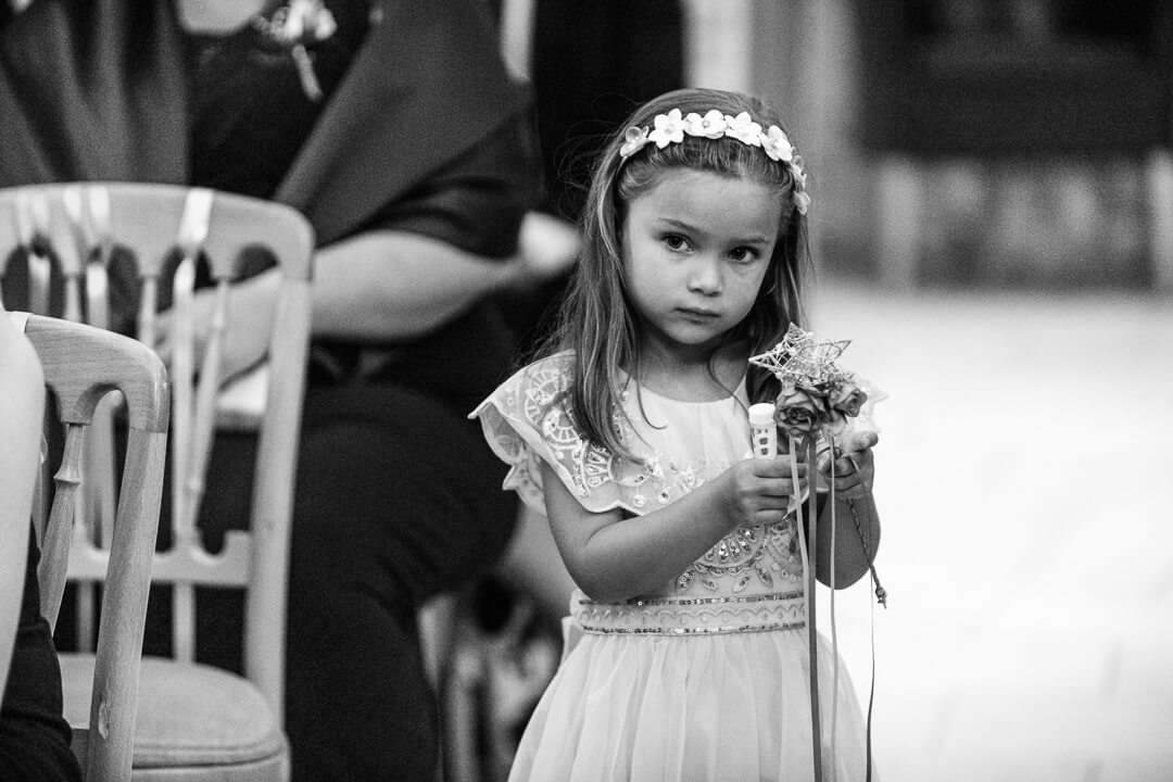 Documentary wedding photo of flower girl
